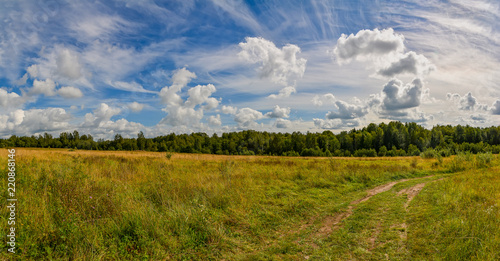 Landscape with clouds in the summer sky. The last days of August. - 220868146