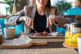 Close-up of girl with Cutlery in restaurant eating roast meat - 220868921