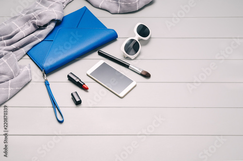 Fashion woman accessories set. Cosmetic makeup. Feminine accessories, flat lay, top viem on gray wooden background with copy space
