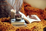 Cozy home with cup of tea with blanket and book. Hygge home interior  - 220870551