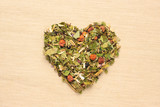 Dried herb leaves heart shaped on jute surface - 220880786