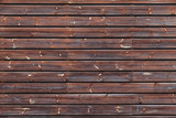 Brown wooden wall made of pine wood planks, texture - 220883735
