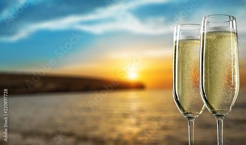 Leinwanddruck Bild Two glasses of champagne isolated on white background