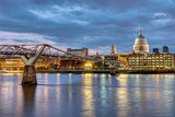 St. Paul's cathedral  and the Millennium Bridge in London, UK, after sunset - 220897992