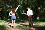 young couple walking in the forest, playing guitar and dancing, summer nature, bright sunlight, shadows and green leaves, romantic feelings - 220908504