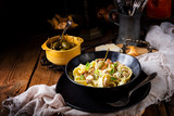 Reginette noodles in cream sauce with fresh chanterelles and capers - 220915714