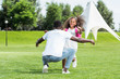 african american schoolgirl running to father with open arms in park