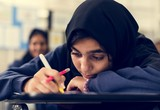Young Muslim student in the class - 220931535