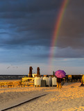 Silhouette of woman with umbrella at sandy beach of the Baltic Sea during sunset, Jurmala, Latvia - 220934165