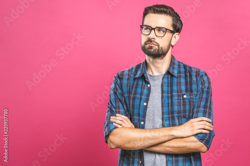 Young man with emotions on his face with a beard on a pink background, logo, copy space. - 220937780