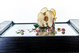 soft white cheese decorated dried apple and green salad - 220943337