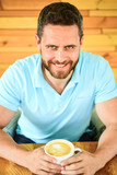 Caffeine can get creative juices flowing when you stuck in rut and it gives you drive. Cafe visitor happy face enjoy coffee caffeine drink. Man bearded guy drinks cappuccino at wooden table cafe - 220948992