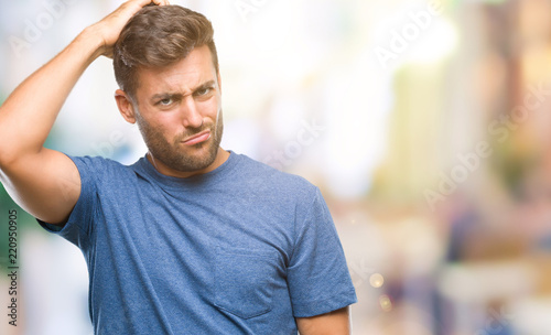 Leinwanddruck Bild Young handsome man over isolated background confuse and wonder about question. Uncertain with doubt, thinking with hand on head. Pensive concept.