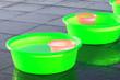 Leinwandbild Motiv Green plastic basin