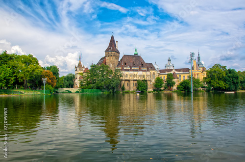 Scenic view of Vajdahunyad Castle reflected in the lake under the picturesque sky in main City Park, Budapest, Hungary