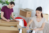 young couple moving in to house - 220959553
