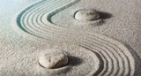 Zen stones in the sand. Grey background - 220967535