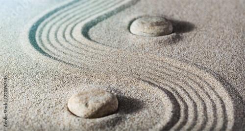 Zen stones in the sand. Grey background - 220967535