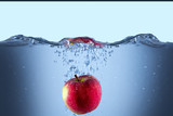 Apple fresh red splash into the water,red fruit food