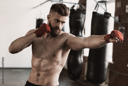 Leinwanddruck Bild Athletic Male Boxer Training at Boxing studio