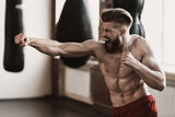 Athletic Male Boxer Training at Boxing studio