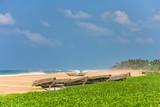 Fishing boat on tropical beach in Sri Lanka - 220980106