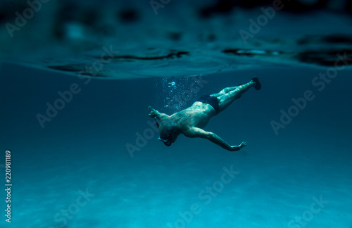 Underwater View Of A Senior Man Floating In Beautiful Ocean 70s 80s