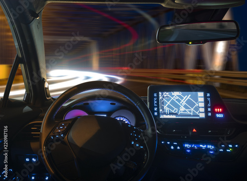 Wall mural concept of the cockpit of an autonomous car driving at night illuminated by a tunnel