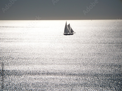 Blue sail boat in the atlantic