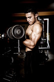 Young muscular man in gym - 220994747