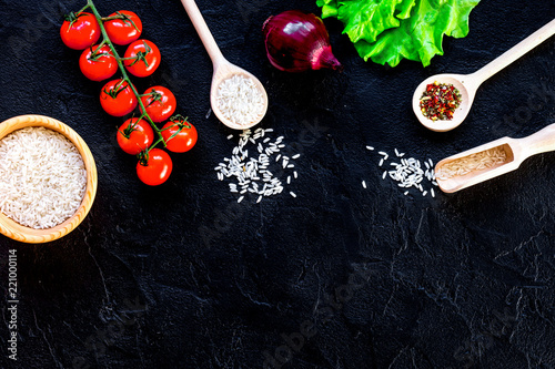 ingredients for paella on dark background top view - 221000114