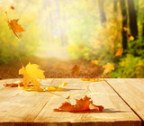 Autumn maple leaves on wooden  table.Falling leaves natural background. - 221010750
