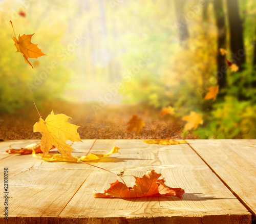 Leinwanddruck Bild Autumn maple leaves on wooden  table.Falling leaves natural background.