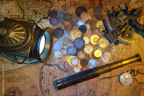 Fototapeta Ship lantern, compass, old coins and sextants. Travel and marine engraving background.Pirate map. Retro style.
