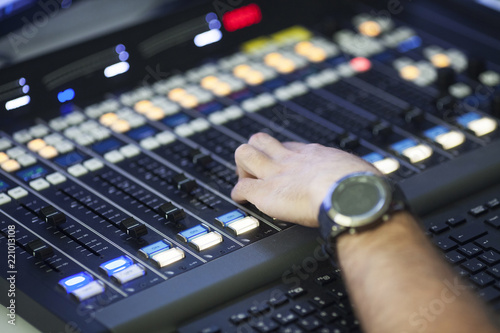 The hand on the sound mixing machine