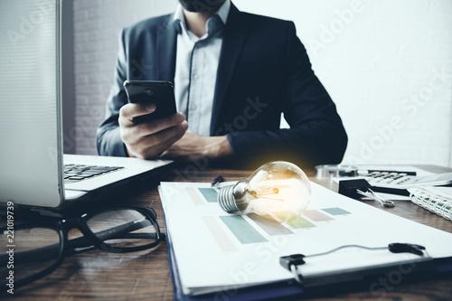 idea or light bulb on document