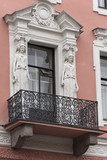 The facade of the old building with a balcony. - 221027948