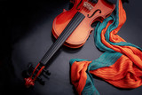 violin on a black table with a color scarf - 221028753