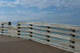 boardwalk railing with a view of the ocean on sunny day
