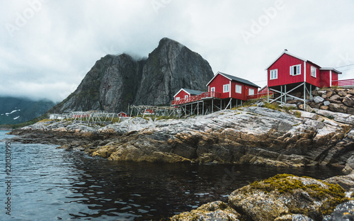 Foto Murales Norway traditional architecture house rorbu and rocky mountains scandinavian travel view landscape, Lofoten islands in Norway