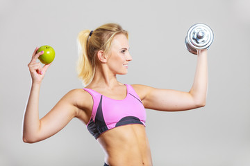 Diet fit body. Girl holds dumbbells and apple fruit © Voyagerix