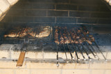 Roasted meat cooked at barbecue. Grilled kebab cooking on metal skewer. BBQ fresh beef meat chop slices. Traditional eastern dish, shish kebab. Grill on charcoal and flame, picnic, street food - 221046177