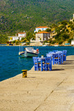 Open cafe outdoor restaurant in Greece on sea shore - 221046715