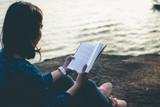 Women read books in quiet nature, concept read a books. - 221062159