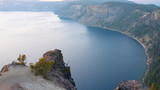Rocky cliff over Crater Lake, Oregon. - 221064118