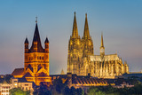 The famous cathedral and Great St. Martin Church in Cologne at dusk - 221066368