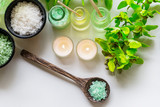 Thai Spa Treatments aroma therapy  salt and nature green sugar scrub and rock massage with green orchid flower on wooden white with candle. Thailand.  Healthy Concept. copy space