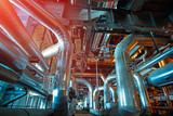 Equipment, cables and piping as found inside of a modern industrial power plant. Industrial zone, Steel pipelines, valves, cables and walkways - 221076953