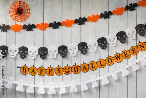 concept of a Halloween holiday on a white wooden background