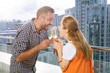 New home. Joyful delighted married couple standing together on a balcony while having a celebration